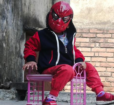 The boy as spiderman